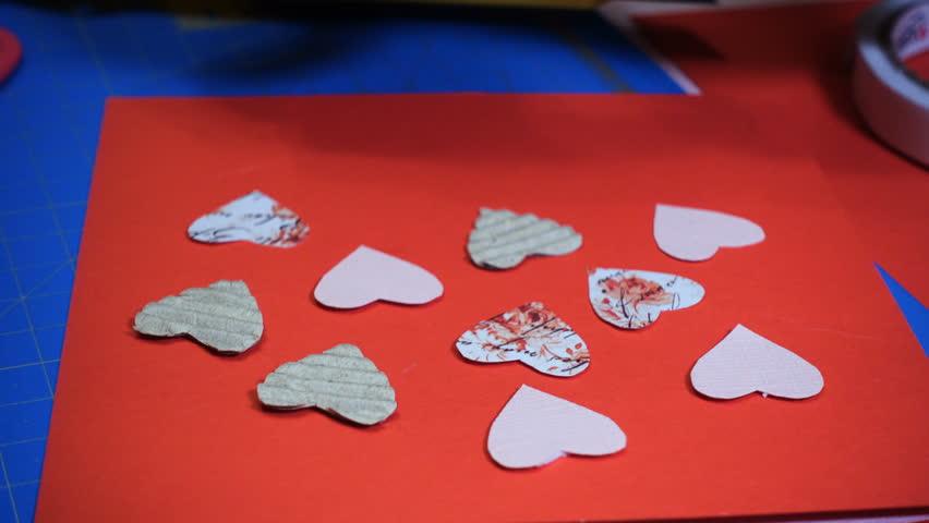 Hands of girl making scrap valentine greeting card stock footage hands of girl making scrap valentine greeting card 4k stock video clip m4hsunfo