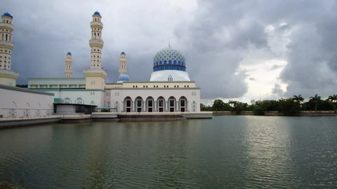 Time lapse of sunset and scattered clouds at the Likas Mosque or Masjid Bandaraya Likas in Likas, Kota Kinabalu, Sabah, Malaysia.
