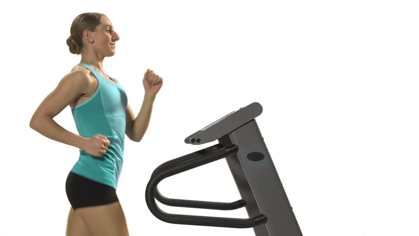 Young Woman Running On The Treadmill In Front Of Green ...