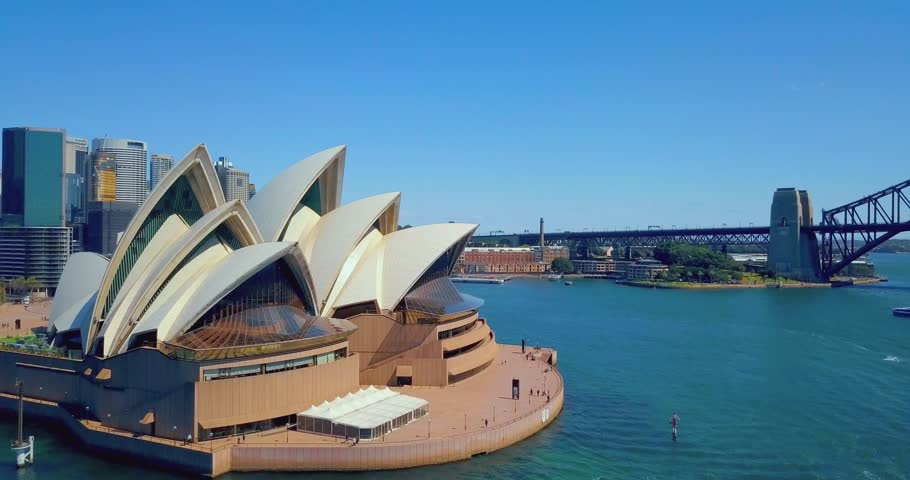 Gorgeous Sydney opera house aerial view from above with Harbour bridge on the background.