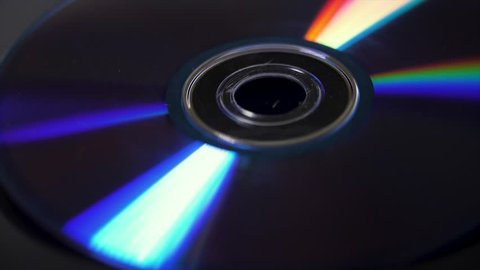 Background of compact disks or dvds. Glare of light on the disk DVD , beautiful colored glare from the light, the background disk DVD