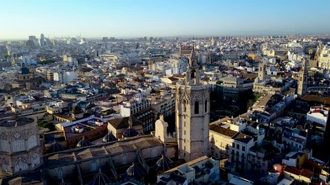 Valencia Spain aerial footage slowly panning around the Miguelet Bell Tower and Cathedral.