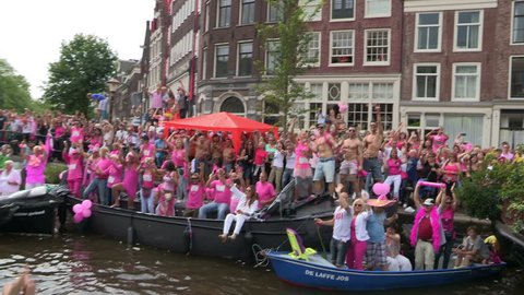 AMSTERDAM, HOLLAND - AUGUST 4: Gay Pride Canal Parade Amsterdam 2012 filmed from one of the parading boats - August 4, 2012 in Amsterdam, the Netherlands.