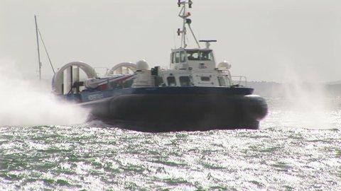 Hovercraft on the Solent arriving at Portsmouth harbor, England.