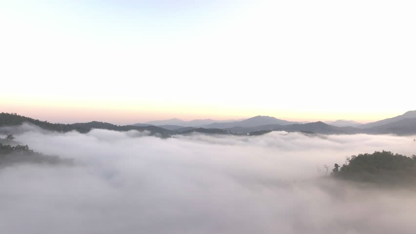 aerial shot : cloud surfing in mountain rang sunrise background #34709359