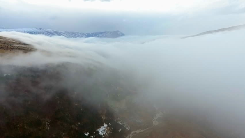 Flying above the clouds in the mountains. Clouds approaching | Shutterstock HD Video #34719049