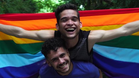 Gay Couple Piggybacking with Rainbow Flag