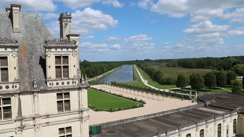 Château Chambord, Looking Over Water With Cloudy Blue Sky In The Loire Valley, France
