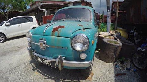 GEORGE TOWN. PENANG. MALAYSIA - CIRCA MAY 2017: Ancient rusty vintage car Fiat-500 70th