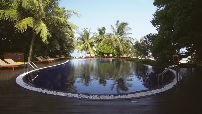 Luxury resort hotels pool on vaadhoo island offers a stunning maldives circa dec 2016 swimming pool at luxury resort hotel on vaadhoo publicscrutiny Gallery