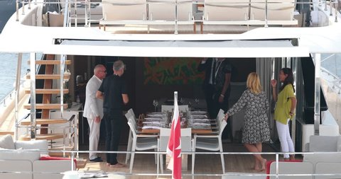Monaco, Monte-Carlo, 29 September 2017: The yacht broker shows the mega yacht to the rich client on Yacht show, richest people on tenders, cityscape, exhibition stands, exhibitors, billionaires, MYS