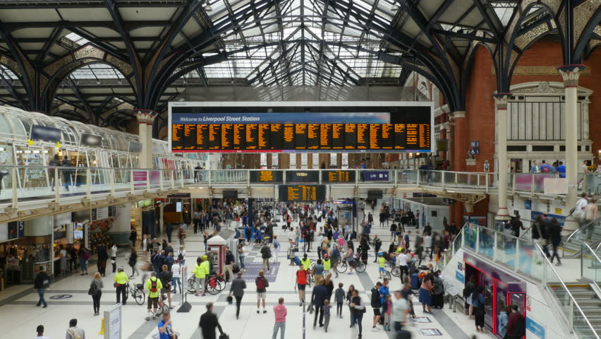 Busy Train Station People Travelling Time-Lapse 4K. Ultra HD locked off video time-lapse of people at bust train station in London, England. No recognizable logos or faces. | Shutterstock HD Video #34829059