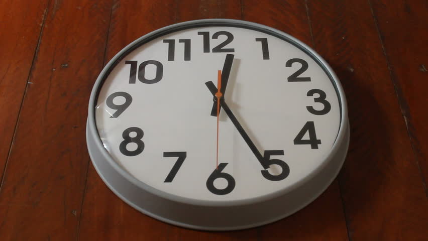White simple wall clock on wooden wall with red second hand show time is passing by. | Shutterstock HD Video #34836469