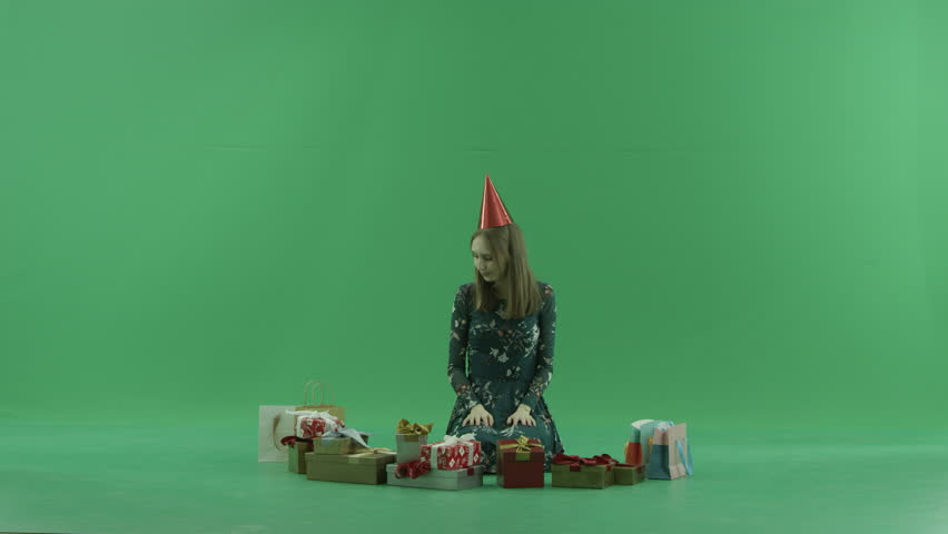 Attractive young woman in cap got a bad Christmas gift, chroma key background   Shutterstock HD Video #34837339