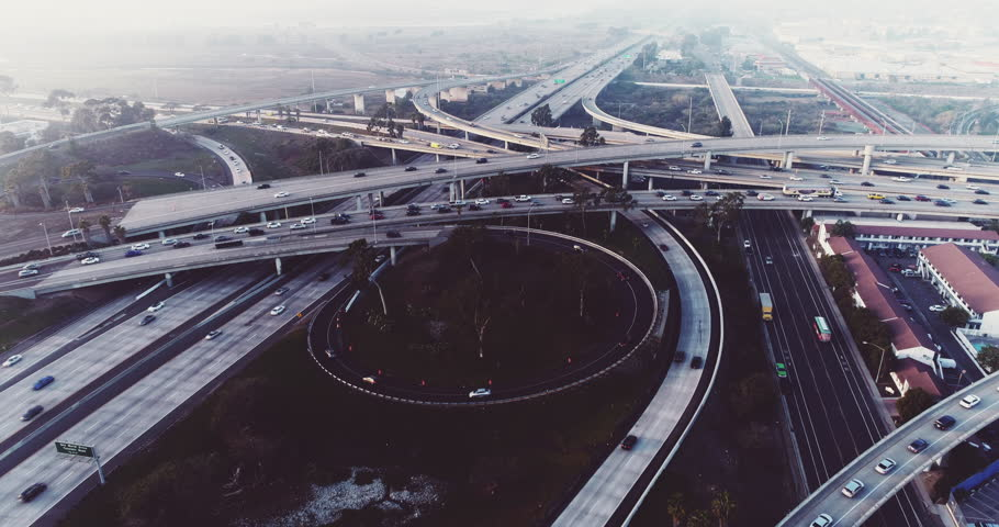 Above busy freeway intersection at sunset during rush hour traffic - aerial shot | Shutterstock HD Video #34855369
