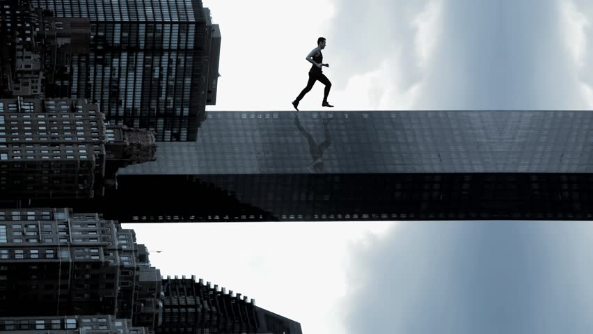 man running in slow motion. powerful superhero. success. successful. career confident. business. epic amazing. skyline city urban style