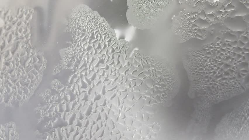 misted glass from hot steam boiling water