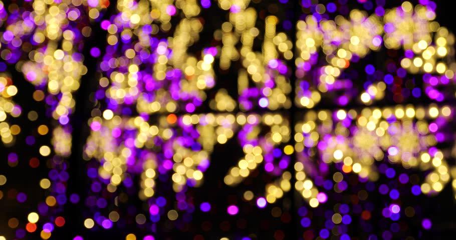 Blurred christmas lights in an evening city | Shutterstock HD Video #34945939