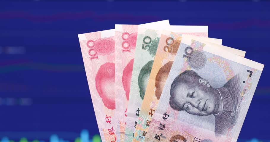 Chinese banknote over stock market screen background | Shutterstock HD Video #34946746
