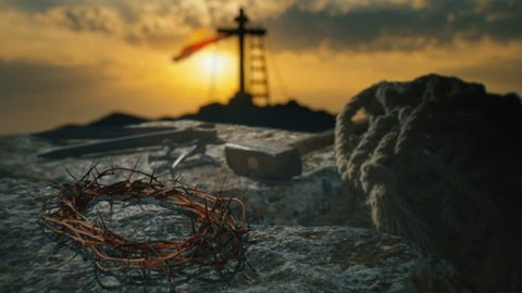Crucifixion of Jesus Christ. Crown of thorns with nails, hammer, pliers and a rope placed on a stone.