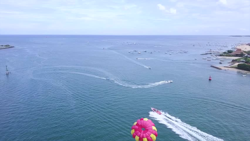 From above follow parachute sailing and boat, nusa dua bali water sports activity | Shutterstock HD Video #34953511