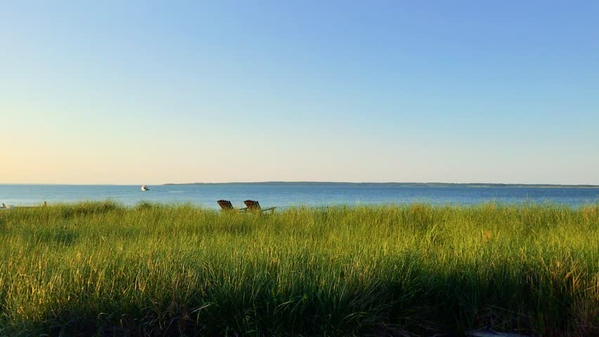 Bay View with green grass, sky and boat_East Hampton, New York   Shutterstock HD Video #34966309