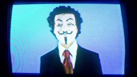 05  January 2018 - a cutout retro television turning in space with man with vendetta mask on the screen