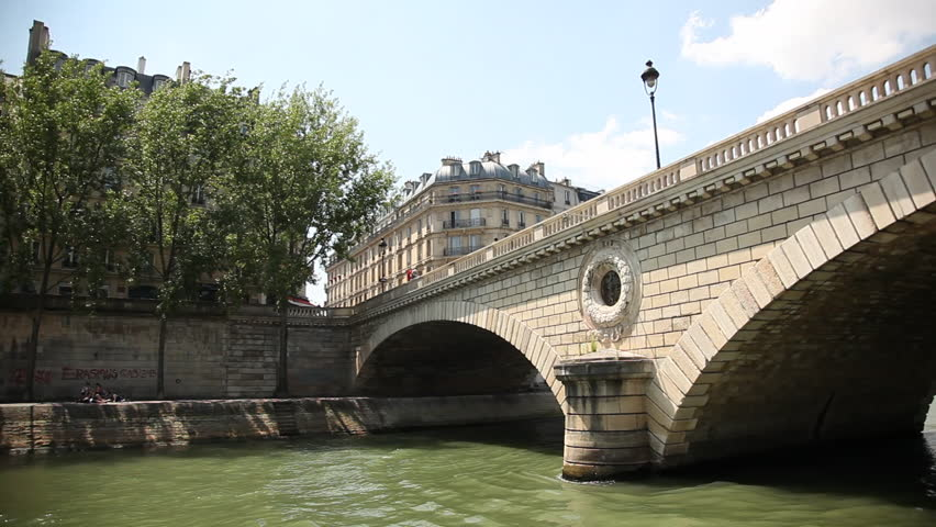 FRANCE, PARIS - JUNE 2013. Riverboat riding on the Seine river in Paris under Pont Louis-Philippe | Shutterstock HD Video #34990768