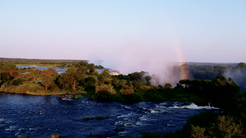 Incredible aerial view of the Victoria falls and a rainbow