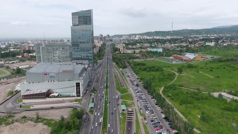 Almaty - MAY 2017: Aerial shot of the  Ritz-Carlton building and moving cars in front of it