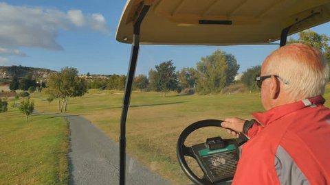 Man drives on golf car