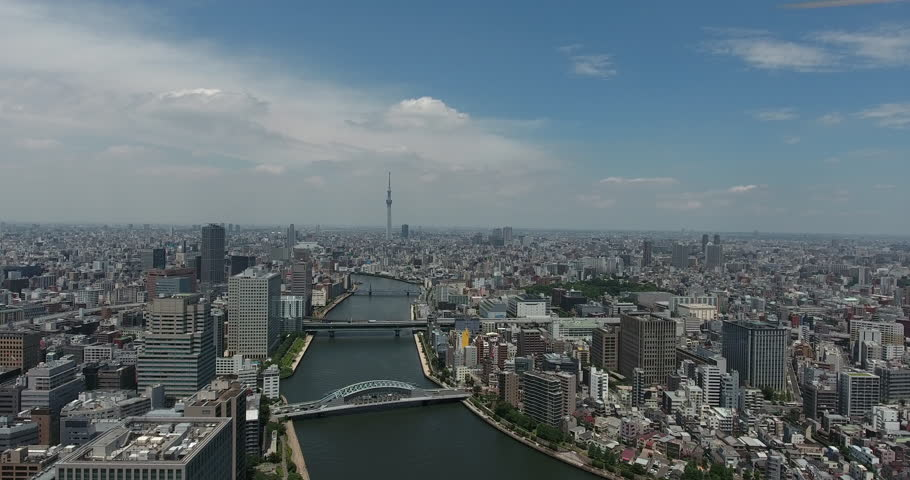 TOKYO, JAPAN – JUNE 2016 : Aerial shot of Tokyo Harbour area and central cityscape on a beautiful day | Shutterstock HD Video #35037679