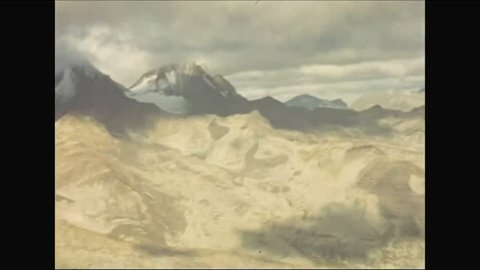 CIRCA - 1952 - Mountain ranges in Kodiak, Alaska are shot from a glider in daytime through sunset.