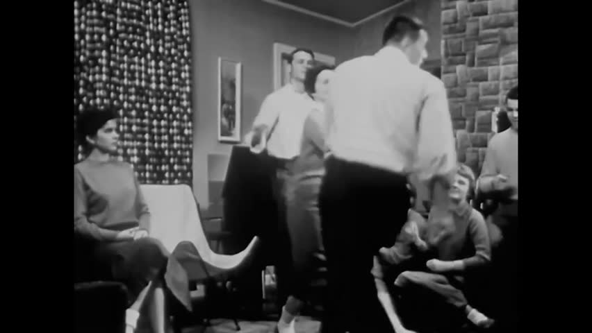 CIRCA - 1958 - When an unpopular girl turns down a popular boy's invitation to dance at a party, another boy calls her a snob.