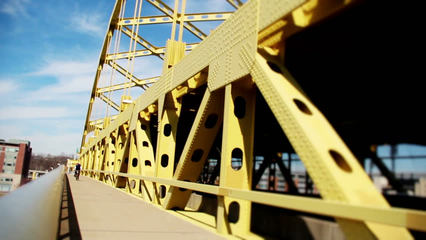 A bicycle rider on the bike trail on the Fort Duquesne Bridge in Pittsburgh,