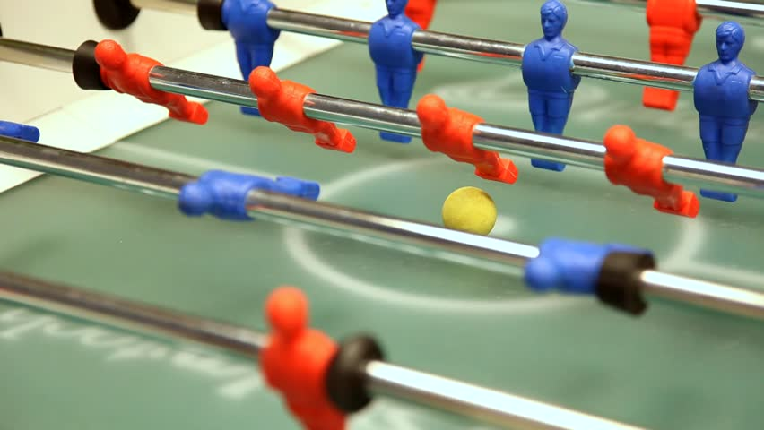 Kick off strike in table football game.
