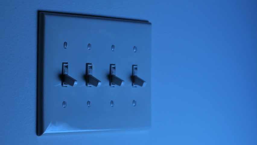 HD video of multiple light switches being turned on and off, one at a time, with