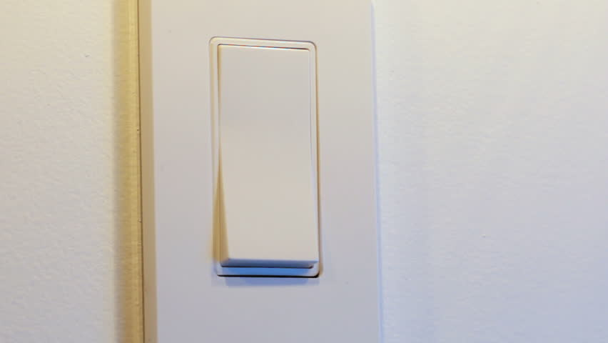 Two close up clips of woman's had turning light on and off, hand groping wall to