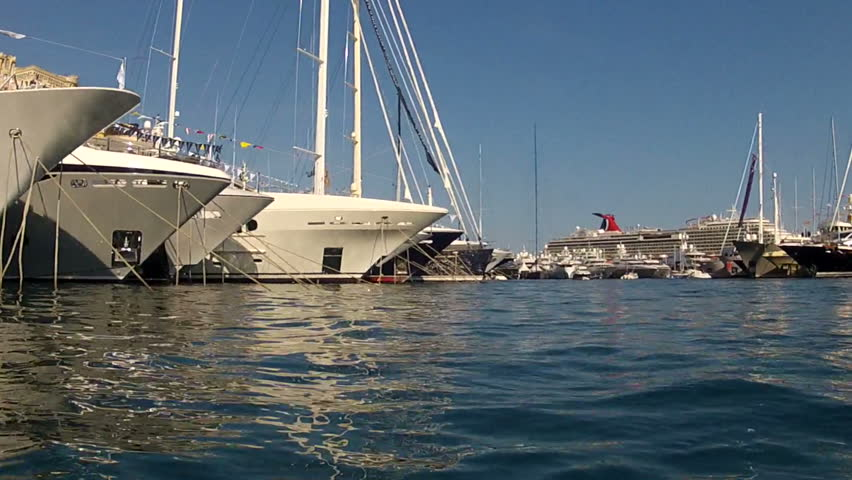 view from surface of water passing infront of large super yachts moored in Port Hercules, Monaco. GoPro HERO2