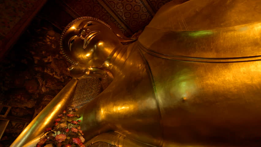 BANGKOK - MARCH 16. Reclining Buddha in Wat Pho temple on March 16, 2012 in Bangkok, Thailand. Wat Pho is named after a monastery in India where Buddha is believed to have lived.