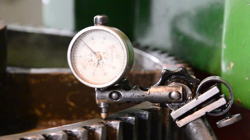 dial gauge instrument measures inclination of cogwheel gear ready for service