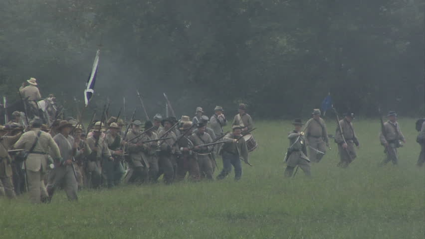 CHICKAMAUGA, GEORGIA - OCTOBER 2008 - large-scale, epic Civil War anniversary reenactment -- in the middle of battle.  Confederate Infantry line of battle advances and fires a volley in combat at Union Army
