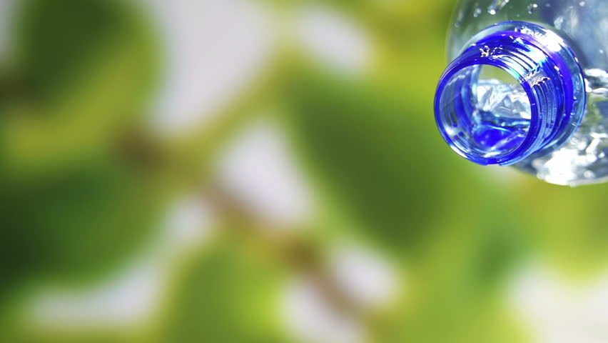 Fresh cool water pouring from a clean plastic water bottle. | Shutterstock HD Video #3569114