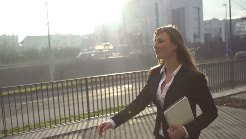 SLOW MOTION: Young businesswoman going to work in the morning | Shutterstock Video #3579872