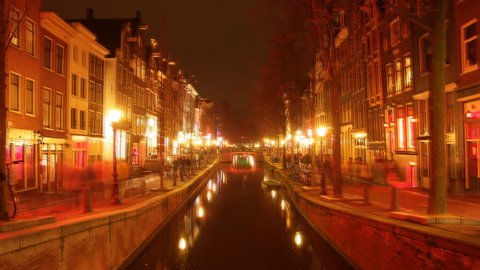 time-lapse shot of the red light district, amsterdam at night