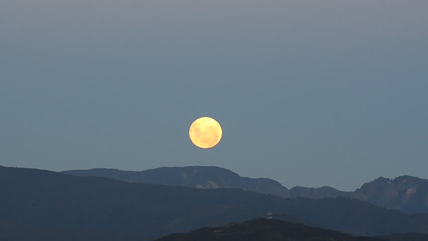 Moon rising over the mountains of Wellington New Zealand at night
