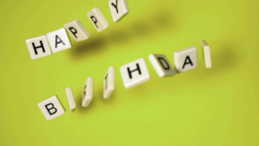 Plastic letters bouncing and spelling out happy birthday in slow motion