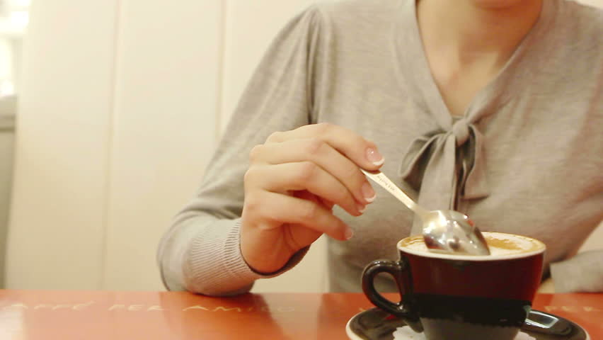 Young woman drink coffee alone