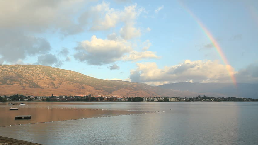 Rainbow, Osoyoos Lake, British Columbia. A rainbow curves over the hills surrounding Osoyoos Lake. Okanagan, British Columbia, Canada.