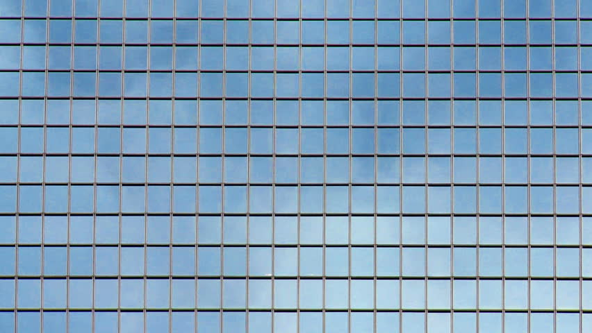 Timelapse clouds reflected in the glass windows of a for Exterior glass wall texture